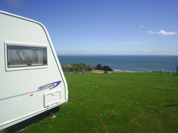 Caravan pitches overlooking Three Cliffs Bay